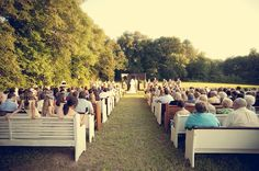 Love the idea of bringing church pews as seating for an outdoor wedding.