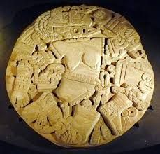 Ancient Aztec sculpture disc from the Templo Mayor, showing a goddess sliced and diced by her brother. Some archaeologists believe that the decapitated and limbless body of sacrifice victims were tossed down the pyramid onto this disc. Ancient Aztecs, Ancient Civilizations, Ancient Art, Ancient History, Ancient Ruins, Aztec Religion, Aztec Culture, Mexica, Mesoamerican