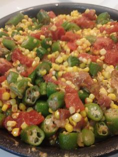 side dish: spanish corn with okra, tomatoes bacon for flavor and onions