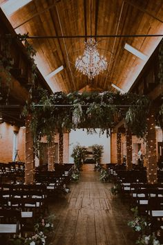 This rustic and industrial space at The Booking House is the perfect setting for an intimate and elegant wedding | Image by Sarah B Photography