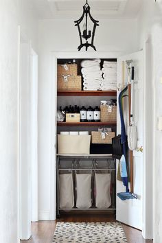 These hanging canvas laundry bags are a nice idea for organizing clothes before laundry day.