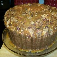 Pecan Pie Pound Cake is a decadent treat you can make at home. Crunchy pecans, gooey caramel sauce, buttery pound cake... so good! #thinkfisher #dessert #pecans
