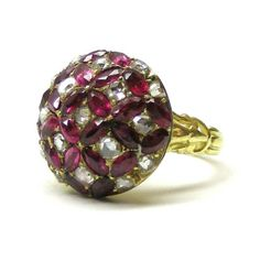 Antique ruby and diamond bombe cluster ring -  The dome shaped bezel set with navette-cut rubies and rose-cut diamonds. English c.1840