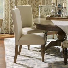 Make more room at the dinner table with our Oatmeal Burlap Parsons Chair. This classic chair is given a rustic twist with oatmeal linen and natural burlap upholstery, perfect for the friend who likes neutral colors and simple lines!