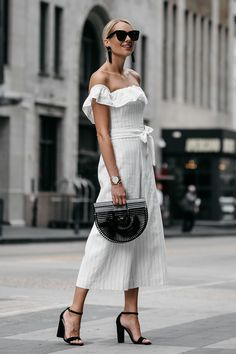 Fashion Jackson shares the perfect white jumpsuit to wear for summer. The off-the-shoulder & ruffle detail makes this white jumpsuit stylish and chic!