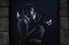 Banksy's latest work 'Mobile Lovers' has been torn down – but for a good cause! according to BGR!