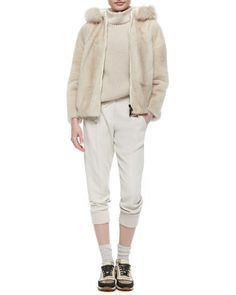 Reversible Mink Jacket with Fox Fur-Trimmed Hood, Cashmere Ribbed Chiffon-Trimmed Tunic & Woven Wool Jogger Pants by Brunello Cucinelli at Neiman Marcus.