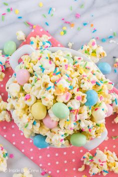 Easter Popcorn - this easy chocolate covered popcorn is loaded with lots of sprinkles and candy. Great no bake recipe that is fun for parties!