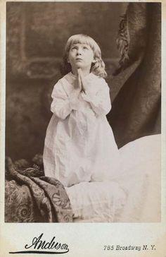 Vintage photo of child praying