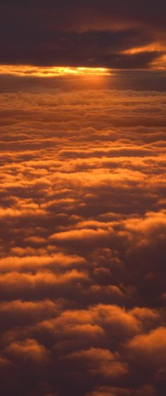 Sunset on the clouds over Seatlle • photo: JD Hascup on Flickr