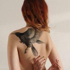 Animal, back tattoo on TattooChief.com