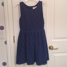 Navy Lace Dress Like new condition. Only worn a few times. A-line fit. Knee-length. Zips up in back. Fully lined. Francesca's Collections Dresses