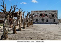EPECUEN, ARGENTINA - DECEMBER 4: Dead City - the enormous volume of water broke the rock and earth embankment, and inundated much of the town, December 4, 2010 in Epecuen, Argentina. by Dmitry Berkut, via ShutterStock