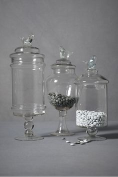 Swallows sitting atop glass jars - perfect for a Candy Store/Bar theme at Christmas on the Kitchen Bar!