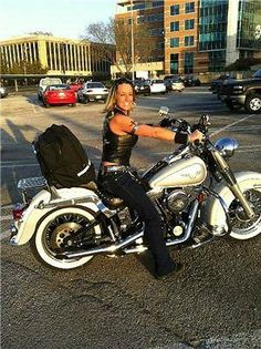 Real biker chick. No helmet, ridin' is livin'