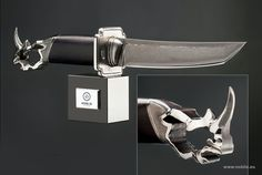 """Knife """"Equilibrium"""". Forceful knife with patterned forged steel blade, large guard, blackwood handle with metal casted head of rhinoceros. Italian  marble  pedestal. Manufacturing process: 38 days.  from https://noblie.eu"""