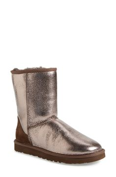 The iconic short UGG Australia boot is updated in shiny metallic leather to add edge to any outfit while keeping feet ultra warm and cozy.