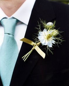Single stems of love in a mist wrapped in pale-green ribbon.