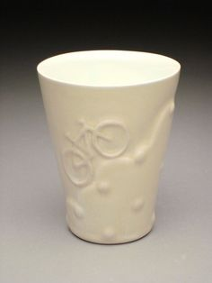 bike cup; DAH ceramics. things to do with slip.