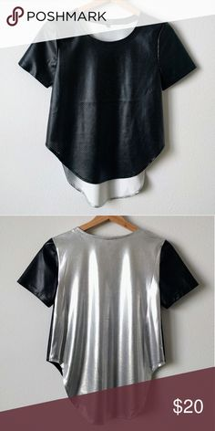 NWOT Private Archives Perforated Metallic back Top Trendy sportswear inspired top. Black, perforated, jersey style faux leather / pleather front and sleeves, silver metallic back. Limited edition top, exclusive design for Forever 21. Side seams come up and hit at waist. Forever 21 Tops