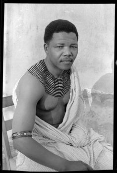 """Nelson Mandela Hiding out from the police during his period as the """"black pimpernel,"""" Saluting his forfathers wearing treditional beads and a bed spread. Photo Eli Weinberg ICP Rise and Fall of Aparheid Weinberg Mandela Photo Star, Xhosa, World Leaders, African American History, British History, Before Us, History Facts, Cuba History, Strange History"""