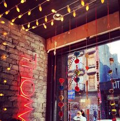 Neon signage + string lights to brighten up a dim space.
