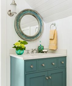 A dose of teal on the vanity and mirror break up the white beadboard in this coastal bath. | Photo: Michael J. Lee | thisoldhouse.com