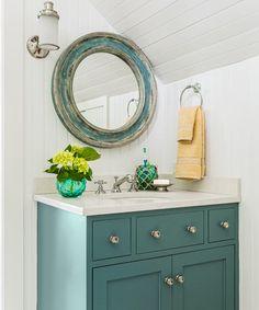 blue vanity + coastal mirror