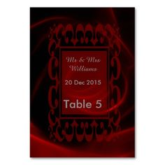 Red Rose wedding table card with table guests listed at the back .