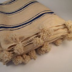 pom pom moroccan blanket/mercado kneeland co.