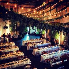 Harvest Style Seating in the main room here at ARIA. Complete with bamboo chairs, vintage classroom chairs, garlands, lights, candles and trees! #weddings #decor