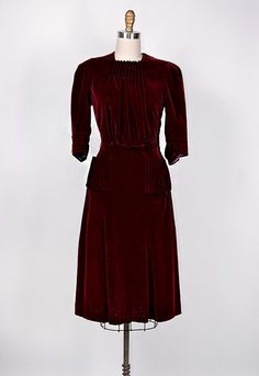 1940s dark cranberry red dress in soft velvet. Stunning pleating on the front that creates a blouson effect. Patch pockets with gathered detailing.