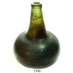 English  black glass  onion bottle, early 1700s.
