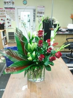 Silver wire with red roses, white lilies and white Glads
