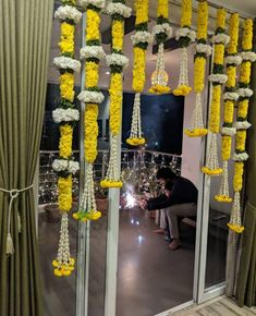 Marigold tassles at the entrance. Diwali Decorations At Home, Marriage Decoration, Wedding Stage Decorations, Engagement Decorations, Festival Decorations, Flower Decoration For Ganpati, Housewarming Decorations, Traditional Wedding Decor, Wedding Mandap