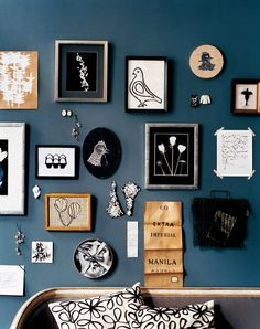 Break up the grid arrangement on your wall by using found objects and different types of textures.