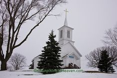 White Country Church in a snow covered mountain.