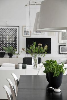 Decorated in black and white, to make room for the colorful family and its creativity.  LOVE.