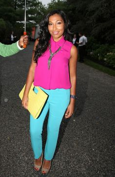 The songstress floods the Hamptons with vibrant hues in this color-blocked ensemble. Her fuchsia sleeveless top and turquoise pants make one cool combo at Russel Simmons' 13th Annual 'Art For Life' gala.