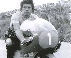 Giacomo Agostini. Most successful world championship rider and perhaps the greatest GP rider of all time. All-time leader in GP victories with 122 wins and 15 World Championships (68 wins and 8 titles in the 500 class, rest in the 350 class). Winner of 10 Isle of Man TTs. U.S. racing debut in 1974, winning the Daytona 200. Long and illustrious racing career of 17 years, winning his final world title in 1975. Last competitive year in 1976, notching up GP wins in both the 350 and 500 classes.