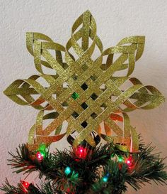 I'm over at Two Girls Being Crafty today as part of their 12 Days of Christmas celebration, and I'm sharing a tutorial on how to create your own woven paper star tree topper Diy Christmas Tree Topper, Christmas Star, Christmas Holidays, Christmas Decorations, Christmas Ornaments, Irish Christmas, Christmas Hanukkah, Snowflake Ornaments, Star Tree Topper