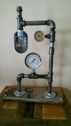 Steampunk vintage accent lighting composed of pipes, gauges and valve handles.. Illuminated by a 40w Edison style bulb, controlled with a rotary valve switch.. https://www.facebook.com/pages/Skramstad-Primitives/340184592831655
