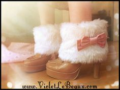 Make your own faux fur boot covers/cuffs - might try this with some zebra faux fur or leopard with a PVC bow :D