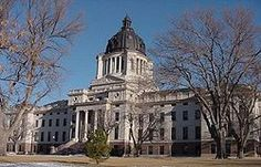 The South Dakota State Capitol building near the Missouri River in downtown Pierre. Pierre is the capital of the U. state of South Dakota and the county seat of Hughes County North Dakota, Pierre South Dakota, South Dakota Travel, South Dakota State, West Virginia Capitol, Louisiana State Capitol, Wyoming, U.s. States, Usa