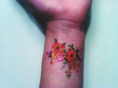Bright Floral Wrist Tattoo
