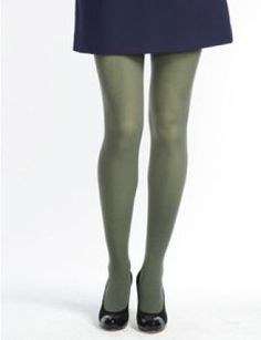 Navy and Olive    The soft, earthy green tights balance the preppiness of a navy skirt for an overall effect that's quite lush.