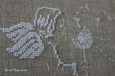 Angel with dandelions, cross stitch
