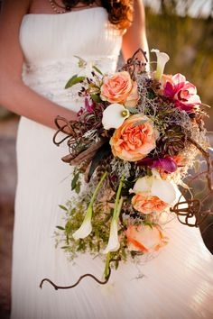 Gorgeous cascade bouquet with succulents, spanish moss and floral. By the talented fellow florists at Garage by Ivy (huge fans of their work!)