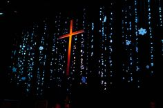 Love the cross being front and center. Maybe use lighting system to project cross up on screen?