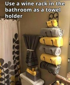 Awesome idea to use a wine rack as a towel rack in the bathroom More by lorie
